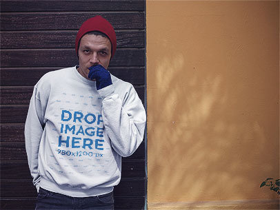 Young Man with a Beanie Wearing a Crewneck in Winter Mockup a13200