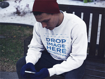 Young Man Texting Out in the Snow Crewneck Sweatshirt Mockup a13204