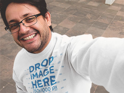 Mockup of a Smiling Man Wearing a Crewneck Sweatshirt and Taking a Selfie a12911