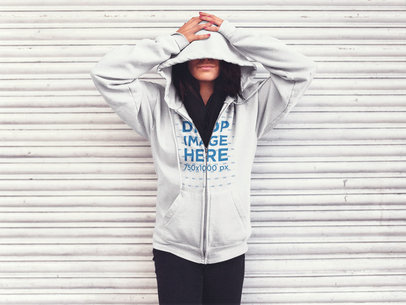 Zip Up Hoodie Mockup Featuring a Girl in the Street with her Face Covered a13178