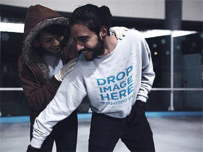 Young Man Playing with his Girlfriend at a Skating Rink Wearing a Crewneck Mockup a13250