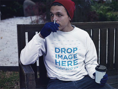 Guy with a Coffee and Smoking Wearing a Crewneck Mockup in the Snow b13203