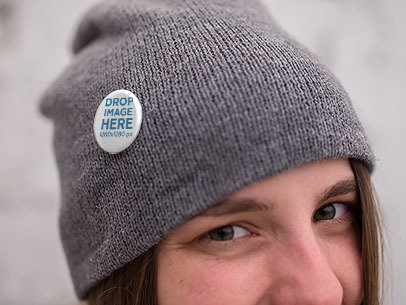 Mockup of a Girl Wearing a Button on a Grey Beanie a14287