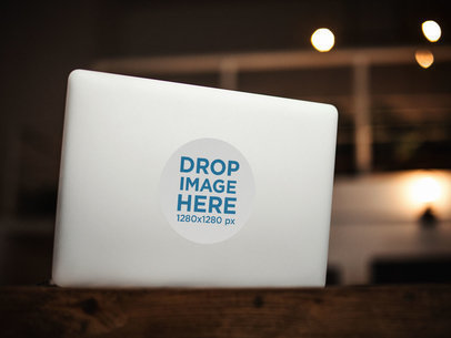 Sticker on the Back of an Opened MacBook Template a14307