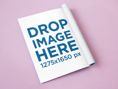 Open Folded Magazine Lying Over a Pink Surface Mockup a14483