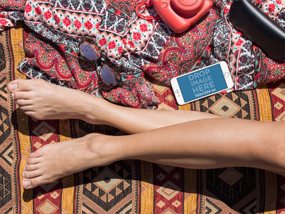 Mockup of a White iPhone 6 Lying Near a Woman Legs in Landscape Position a14293