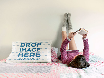 Young Girl Reading Upside Down Near to a Pillow Mockup a14939
