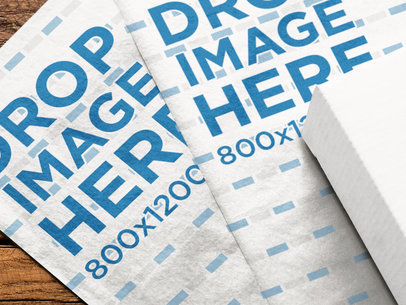 Pair of Wrapping Papers Mockup Lying Together on a Wooden Surface a14960