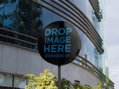 Round Sign Mockup Standing Outside a Big Mall a14970