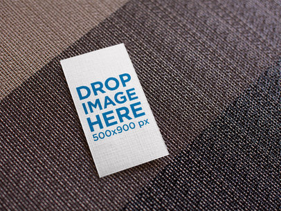 Vertical Business Card Mockup Lying on a Brown Grayscale Surface a15023