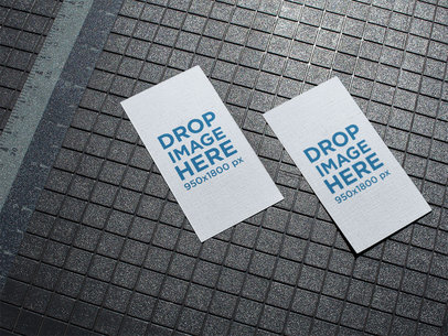 Pair of Vertical Business Cards Mockup Lying on a Patterned Floor a15010