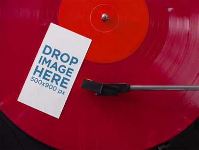 Vertical Business Card Mockup Lying on a Red Vinyl LP a15024