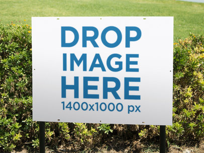 Real Estate Lawn Sign Mockup Outdoors Near the Grass and a Bush a14980