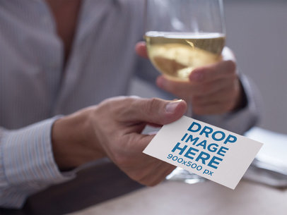 Man Handing a Business Card Mockup While Drinking White Wine a15033