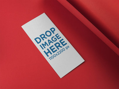 Trifold Brochure Mockup Lying on a Red Surface a15199
