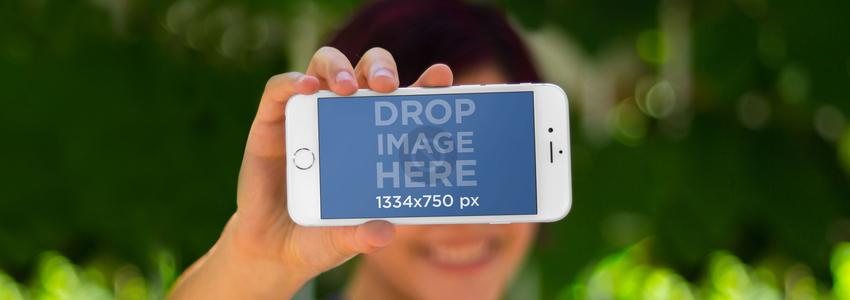 Woman Holing iPhone 6 Frontal Shot Bokeh Wide