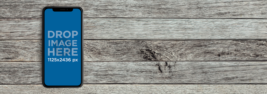 iPhone X Mockup Lying Over a Gray Wooden Surface a17197