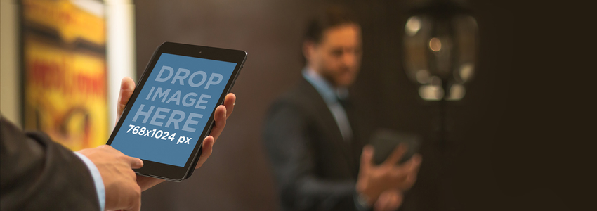 Mockup of a Corporate Man Using a Black iPad Mini Placeit Stage Image