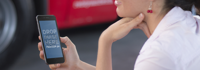 Mockup of Young Lady Using a Black iPhone 6 Featuring a Red Vehicle