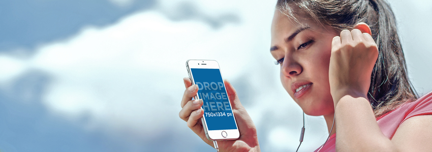 Mockup of a Young Female Athlete Using a White iPhone 6