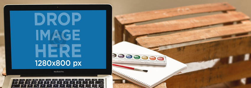 Laptop Mockup of a Macbook Pro at an Art Studio