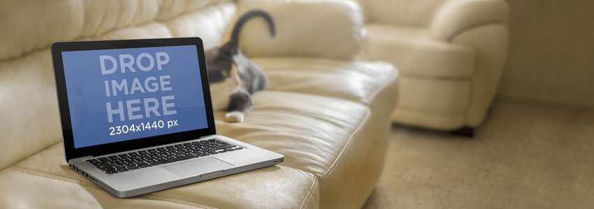 Mockup Template of a Macbook Pro on White Leather Couch Placeit Stage Image
