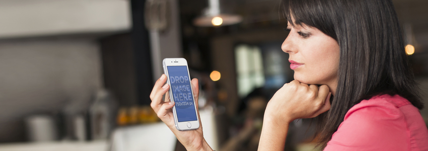 iPhone 6 Mockup Template of a Woman Waiting at a Restaurant