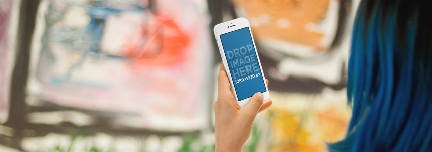 iPhone 6 Mockup Featuring a Woman at an Art Gallery Exhibition  a3029