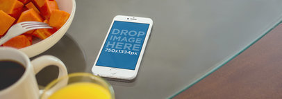 iPhone 6 Mockup of an iPhone Lying on Top of a Crystal Dining Table A2994