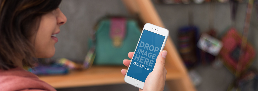 iPhone 6 Mockup Featuring a Woman Using an iPhone at a Local Boutique a3031wide