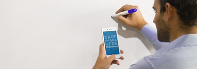 iPhone 6 Mockup of a Man Taking Notes on Whiteboard a2854