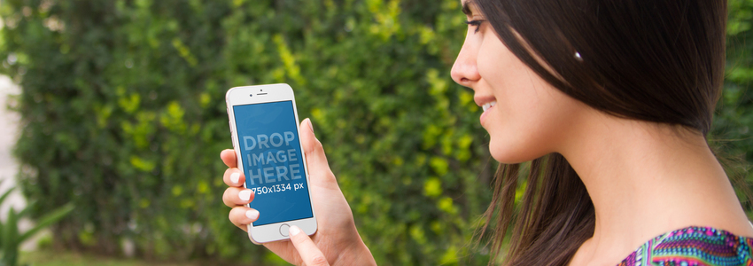 iPhone 6 Mockup Template of a Beautiful Girl at the Garden a4432