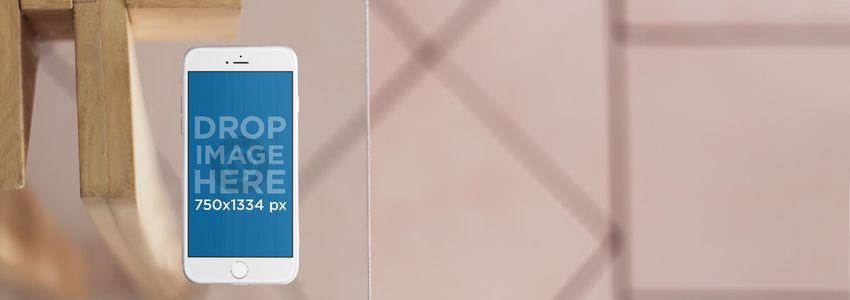 iPhone 6 Mockup Template Over a Glass Table a4289