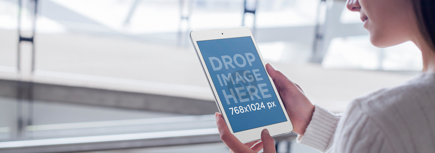 Mockup of a Young Woman Using a White iPad Mini a4570