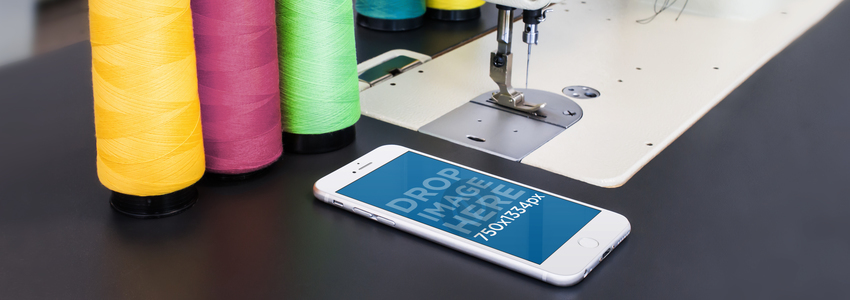 Mockup of an iPhone 6 Lying Next to a Sewing Machine a4649