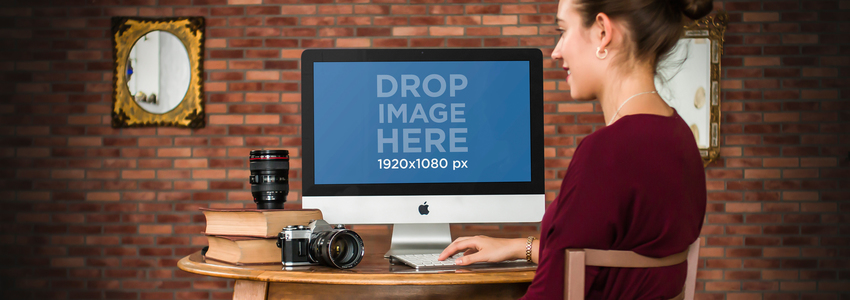 Mockup of a Young Female Photographer Working on an iMac a4858