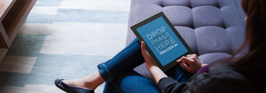 iPad Mockup of a Woman Sitting on a Couch Using an iPad a4918