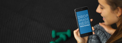 iPhone Mockup of a Young Woman at the Gym Using an iPhone 6 4802A