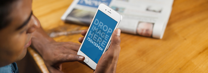 iPhone Mockup of a Young Man Reading the News on his iPhone 6 a5068