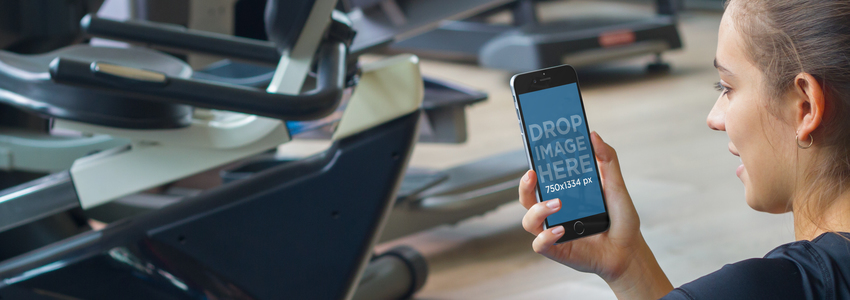 Young Woman Using iPhone 6 at the Gym Mockup a4807
