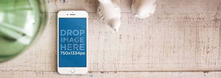 iPhone 6 Lying on Top of a White Wooden Cabinet Mockup a5540wide