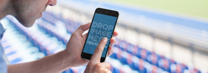 Mockup Featuring a Man Using an iPhone 6 at a Soccer Stadium a5450