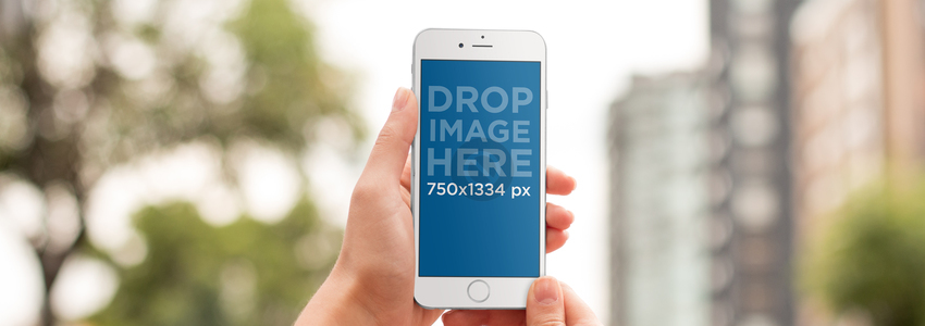 iPhone Mockup Being Used in an Urban Environment a9373