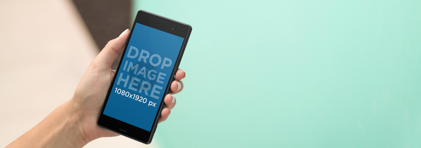 Android Phone Mockup in Front of a Blue Background a9492