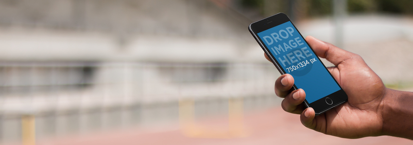 Mockup Template of a Man Using an iPhone at a Running Track