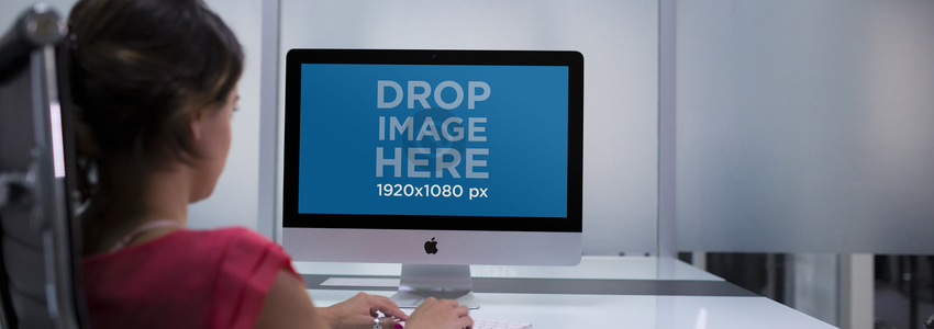 iMac Mockup Featuring a Young Woman Working at her Office a12338