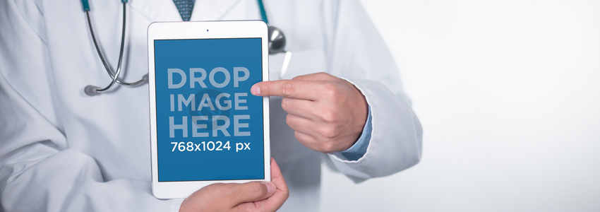 White iPad Mini Mockup Held in Portrait Position by a Doctor a12406