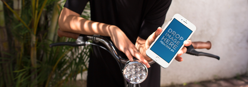 White iPhone 6 in Portrait Position Held by a Trendy Young Woman Ready to Ride her Bike a12949wideb