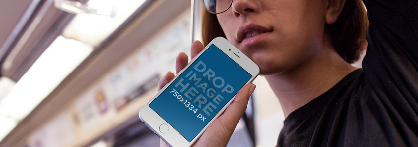 Young Woman with Glasses Riding the Metro Holding her White iPhone 6s in Portrait Position Mockup a12960w