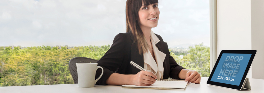 Business Woman Using An iPad At The Office Wide